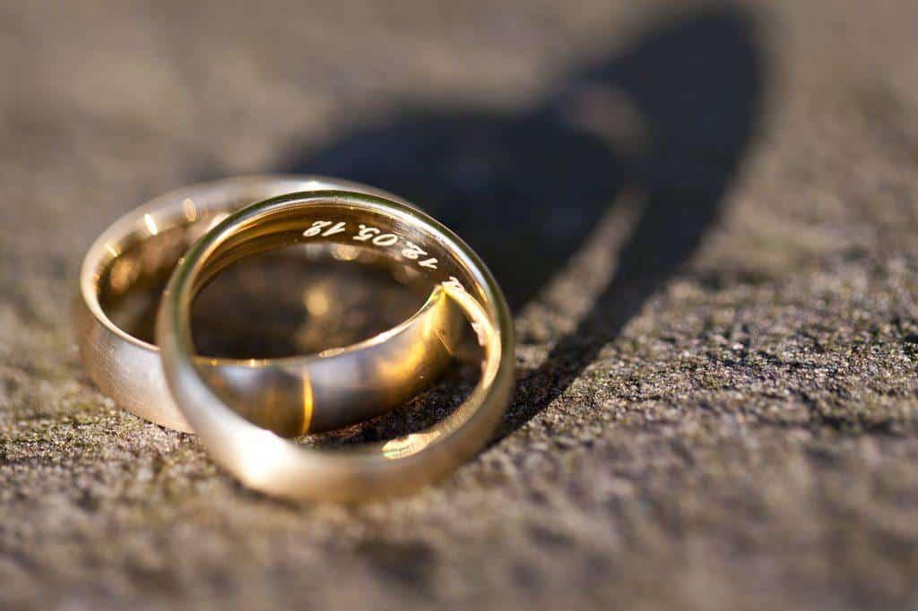 weddings rings in sand