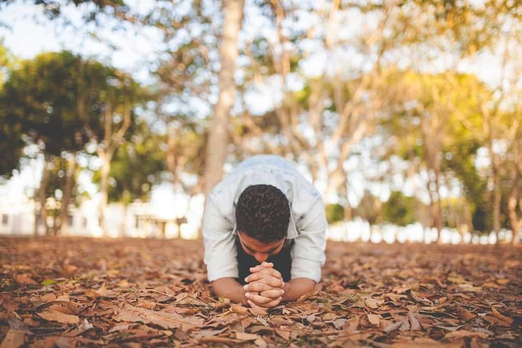 man praying with passion